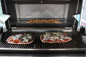 Pizzas cooking on the grill