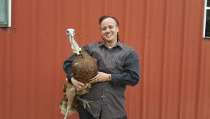 Artist Bug holding a turkey