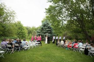 Wedding Ceremony 100 Guests Blue Spruce Background
