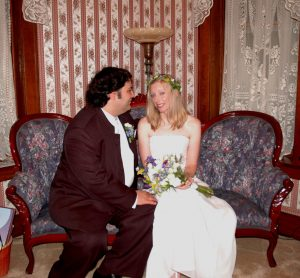 Wedding Couple Sitting in Parlor