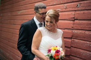 Wedding Couple with Barn Backdrop