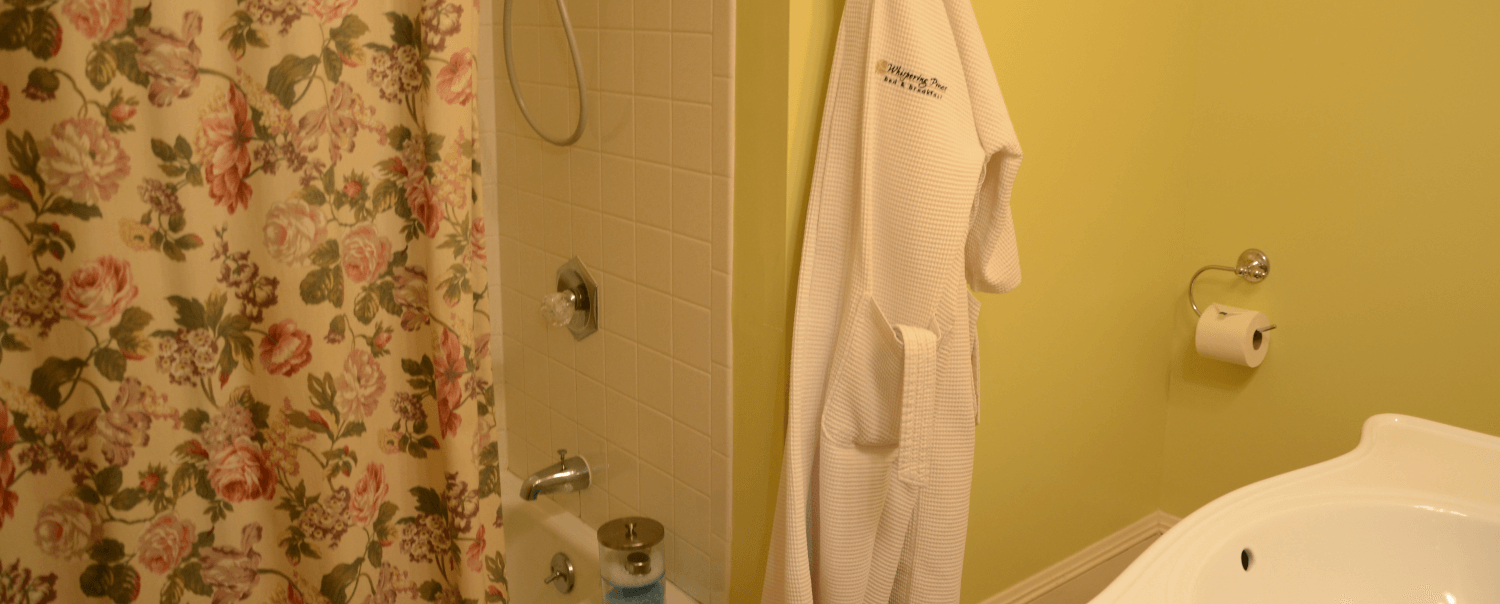 Rose Bathroom with Tub/Shower, Robes and Bath Salts